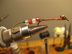 The beads are optional but I think they give the fly an extra boost and it keeps the hook from fouling